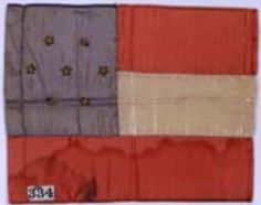 """7-star First National pattern miniature flag made by Baltimore woman. She was reportedly arrested for wearing the flag against Federal regulations. 6"""" x 7"""". Museum of the Confederacy Collection."""