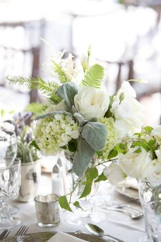 Green and White Flower Arrangement and Table with Hydrangeas, White Roses, and Dusty Miller  Photography By / biasampaio.com, Planning By / dariaculverevents.com, Floral Design By / klenahandesigns.com
