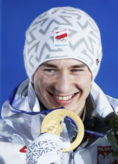 Gold medalist Kamil Stoch of Poland poses during medal ceremony for men's ski jumping individual normal hill event, during medal present...