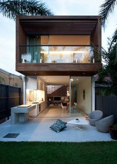 North Bondi House by MCK Architects. Simple design, good use of cantilevered covered wood deck, flexible open plan.: