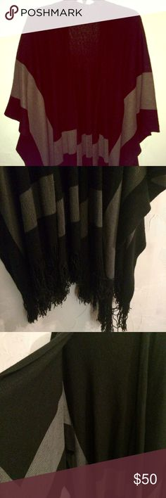 BCBG Poncho/Wrap Great (like-new) condition. Black gray contrast and fringe at bottom. Brand tag no longer inside, but authentic and BCBG. BCBGeneration Accessories