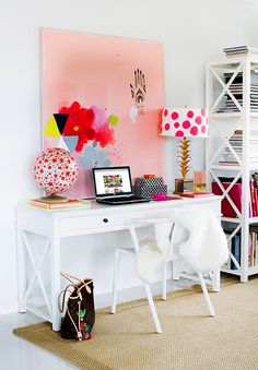modern study, home office with white desk, chair and shelves, bold pink and red art, gold lamp with white and pink polka-dot shade