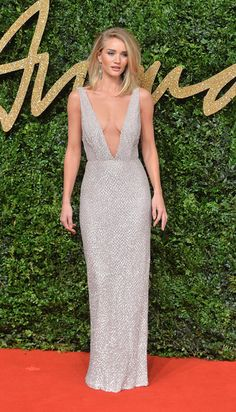 Rosie Huntington-Whiteley cut a sleek figure in a plunging V-neck silver dress for a showstopping gown.  Sign Up for Our Newsletter