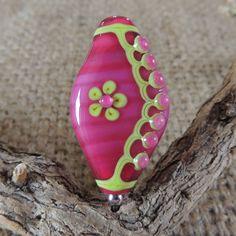 Handmade lampwork flower and leaf detail bead. £18.00, via Etsy.