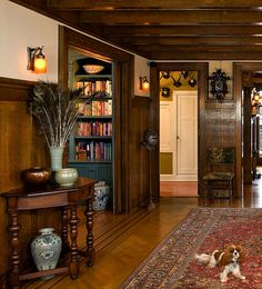 I love the wood panelling and the knights helmet in the hall way.  I really like this old english medieval home decor.  Its very warm and romantic