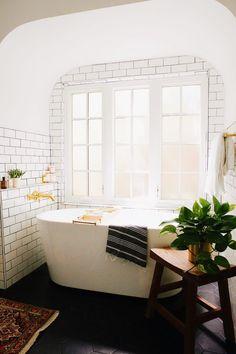 subway tile, windows, and a soaking tup