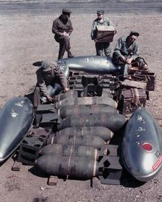 8th Air Force ground crew with the typical ordnance (machine gun ammunition, bombs, and drop tanks) for P-51 Mustang fighters in action over Europe during WWII. (U.S. Air Force Photo.)