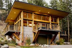 The cabin of Mac Dunstan and Linda Grob on a hillside near Seattle. They built the airy, ultra-modern 1,600-square-foot retreat for 500K four years ago.