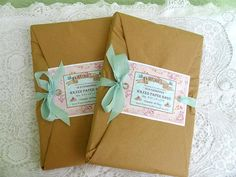 brown packages with mint ribbon