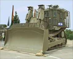Israeli bulldozers often encounter heavy resistance trying to demolish Palestinian camps leading them to develop militarized bulldozer-tanks. Heavy Construction Equipment, Heavy Equipment, Army Vehicles, Armored Vehicles, Caterpillar Bulldozer, Military Engineering, Earth Moving Equipment, Armored Truck, Crawler Tractor
