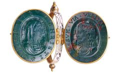 """This reliquary pendant (dated 1501 to 1625) incorporates bloodstone cameos of the head of Christ, with a text from the Gospel of John, """"I am the Way the Truth and the Life,"""" and a profile bust of the Virgin Mary, with the legend """"Mother of Jesus Christ""""."""