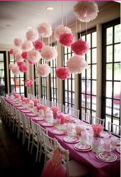 The table is not what we are looking at here. Mrs. Gardner is making pink and yellow tissue balls for above the tables
