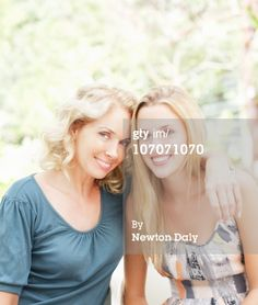 Portrait of mature mother with adult daughter
