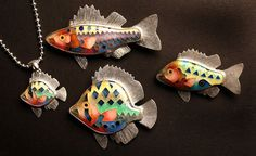 A school of fish brooches and pendants with sterling silver chain by Michael Romanik. (Allison Carey/The Plain Dealer)...