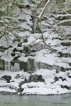 Frozen water along Six Mile Creek in Ithaca (Tompkins County), New York.