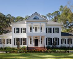White exterior with shutters. Amazing entry with second floor balcony.