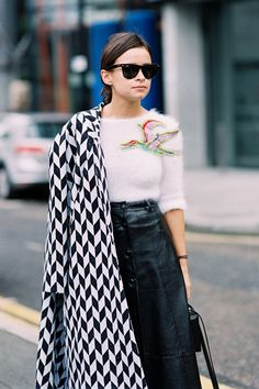 Pair a chevron checkered statement coat with a fuzzy cropped sweater and a button down leather skirt.