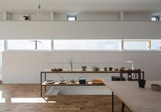 House in Toyonaka by Yo Shimada, from Tato Architects, has three floor. The last one accomodates the living and dining room, as well as the kitchen.