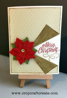 A classic Christmas card - this has been created using CTMH's Oh Deer paper, and the CTMH Flower Market cricut cartridge is the clever creator of the poinsettia.