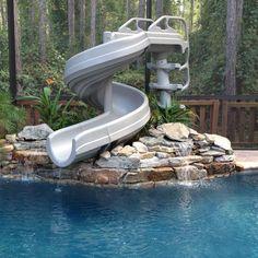 Swimming Pool Slide Ideas swimming poolstriking oval shape backyard pool design ideas with concrete paving deck floor plus G Force 360 Degree Super Pool Slide