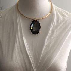 "Gold Choker with Dark Silver Stone Brand New...... Simple gold choker with large gem pendant. Made of alloy and gem. The choker is about 16"" and the gem is about 2"" long. Please feel free to ask questions. No holds, trades, or PP! Thank you! Fashion Jewelry Jewelry Necklaces"
