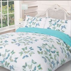 The Melanie Summer Duvet Set has a beautiful butterfly design in teals and greens against a crisp white background.  The reverse is plain teal.