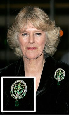 The Ladies of North Wales brooch Camilla accessorized her velvet jacket with this diamond and emerald leek pin, a royal heirloom worn in 1969 by Prince Charles's grandmother the Queen Mother at his investiture as Prince of Wales, at an opera reception in Cardiff, Wales in 2006.