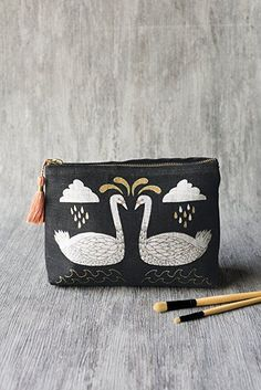 Wild Tale Small Cosmetic Bag - Made from 100% linen and with a vegan leather lining, this small cosmetic bag is perfect for storing your beauty essentials, small accessories, toiletries and more. Enchanting swans and foliage are arranged in harmonious symmetry with golden metallic highlights and peach accents. A pastel peach tassel adds a textured detail. Small Cosmetic Bags, To My Mother, Travel Toiletries, Cat Design, Beauty Essentials, Small Bags, Bag Making, Vegan Leather, Birthday Gifts
