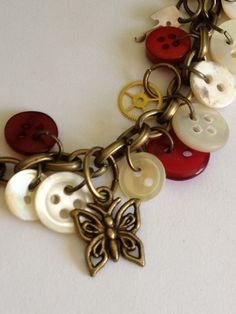 """Steampunk Vintage Buttons and Gears 8"""" Bracelet Vintage Brass Red, White, MOP Buttons Butterfly Charm Ladies Fashion Jewelry Birthday Gift . $24.99, via Etsy."""
