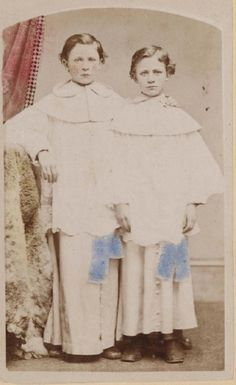 Post mortem... boy on right... is that a stand behind him?
