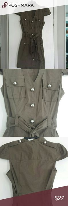 """Express Khaki Green Dress Excellent condition. Cap sleeves. Ties at the waist and buttons up. Cute rounded silver buttons.  23 1/2"""" from armpit to hem. The first picture shows you the shape and fit, but the color isn't the same. The actual dress is more of an army green. Offers are welcome! Bundle to save more! Express Dresses"""