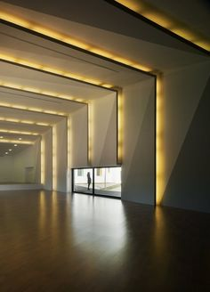 Light builds -  interior, yellow lights on the wall and ceiling creating rhythm