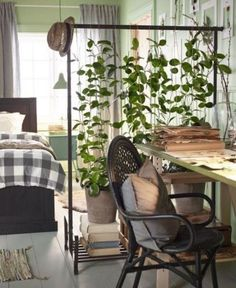 "The challenge: Create a ""bedroom"" (well, at least a bed nook) in an open-layout studio apartment. Our solution: Choose visual dividers that separate the space, but that don't block sunlight or cut up the square footage of an already tiny home. Presto—your single room will suddenly feel like two (or more.)"