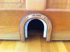 Hole in small door under the stairs for hiding kitty litter.The cat cave/cat hole/cat door. 23 Insanely Clever Products Every Cat Owner Will Want Animal Room, Crazy Cat Lady, Crazy Cats, Cat Shelves, Cat Cave, Small Doors, Cat Room, Cat Furniture, Litter Box