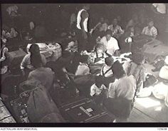 PORT MELBOURNE, VIC. 1946-02-21. THE CROWDED FAMILY QUARTERS IN ONE OF THE FORWARD HOLDS OF THE KOEI (KOYEI) MARU. THE SHIP, A FORMER MINELAYER STILL CREWED BY JAPANESE NAVAL PERSONNEL, ARRIVED TO ...