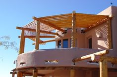Two Story Santa Fe Style Patio. Hand Peeled Dry latillas Top Pine Pole Vigas