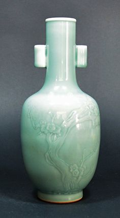 Eighteenth Century Porcelain Vase Green glazed vase with plum tree pattern, with Qing Qianlong mark on base.