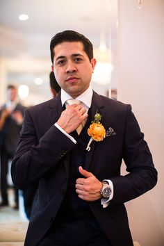 Groom looking debonair as he adjusts his tie. Wedding Coordinator: MB Wedding Design and Events.