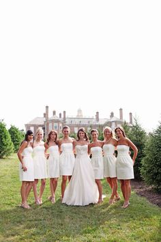 I love the short white bridesmaid dresses with the long white brides dress!