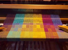 """Natalie Labencki Canfield 4 hrs  A good day for weaving. Draft is """"Four Blocks on Four Shafts: Summer and Winter Towels"""" from May/June 2013 Handwoven. Color combination my own – seemed appropriate. 2 shuttles  https://www.facebook.com/photo.php?fbid=1122310927784144"""