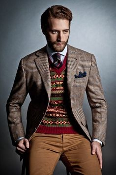 Drakes London - Prince of Wales check patterned sport coat, Fair Isle v-neck sweater, dark striped tie, blue and white striped shirt, brown by carter flynn