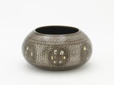 Bowl (forgery) | Origin:  Iran | Period: n.d.a. | Details:  Not Available | Type: Bronze | Size: H: 6.9  W: 13.5  cm | Museum Code: F1908.53 | Photograph and description taken from Freer and the Sackler (Smithsonian) Museums.