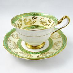 Beautiful bone china tea cup from Royal Albert. Teacup and saucer are green and gold with a floral spray in the center. Gold trimming on cup and saucer edges. Excellent condition (see photos). The markings read: Royal Albert Bone China England Please bear in mind that these are