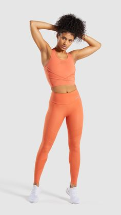 They're assembled with a supportive, high-rise waistband for a stay-put and focused fit and enhanced with ventilating perforation to keep you fresh throughout your workout. Pro Perform aspires to achieve. Cute Workout Outfits, Workout Attire, Womens Workout Outfits, Workout Leggings, Orange Leggings, Best Photo Poses, Gym Wear, Athletic Wear, Deporte
