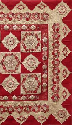 Stunning cream and red quilt by artist Helen Stubbings
