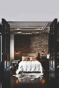 Modern Chic Bedroom with Exposed Brick Wall - Discover home design ideas, furniture, browse photos and plan projects at HG Design Ideas - connecting homeowners with the latest trends in home design & remodeling Dream Bedroom, Home Bedroom, Master Bedroom, Bedroom Ideas, Edgy Bedroom, Bedroom Wall, Bedroom Designs, Bedroom Inspiration, Dark Bedrooms