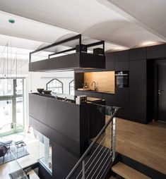 Neulant van Exel Creates The Living Cube Inside an Apartment in Berlin Berlin Apartment, Apartment Layout, Black Cabinets, House Elevation, Coworking Space, Minimalist Kitchen, Open Kitchen, White Walls, Second Floor