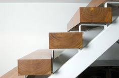 Close up metal and wood strairs.
