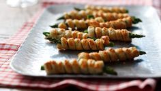 Asparagus and puff pastry cigars...I would wrap 2-3 asperagus at a time...so elegant and yummy!