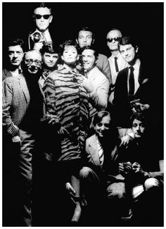 The team of Vogue in 1950 Guy Bourdin right of Dorian Leigh. Henry Clarke with his glasses on top Emerick Bronson far left. Bill Connors behind Dorian Leigh. Joseph Leombruno to his left, Jack Bodi and Maurice Pascal. Bottom right, Willy Rizzo and his friend Helmut Newton Photo Willy Rizzo